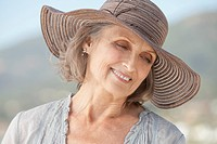 Portrait of happy woman wearing sun hat