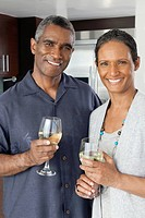 Portrait of happy couple holding wineglasses
