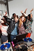 Disc jockeys dancing at party