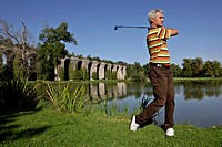 GOLFER IN FRONT OF THE AQUEDUCT OF MAINTENON, EURE_ET_LOIR 28, FRANCE