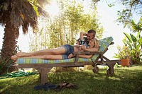 Mid adult couple resting on sun lounger