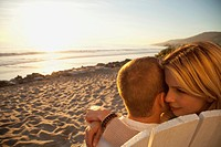 Young couple on beach (thumbnail)