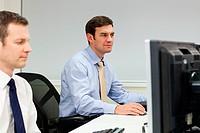 Businessmen using computers