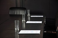 Conference table with drinking glasses and documents