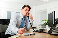 Office worker on telephone call