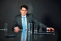 Businessman in conference room with documents