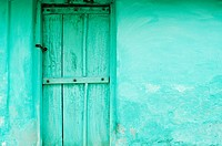 Green wooden door and wall of village house near Mysore, Karnataka (thumbnail)