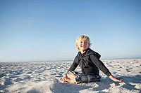 Boy 3_4 sitting on beach