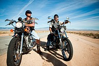 Two men parked on motorcycles at roadside (thumbnail)