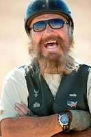 Portrait of senior motorcyclist laughing (thumbnail)