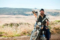 Portrait of senior motorcyclist