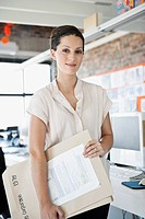 Portrait of smiling woman in office (thumbnail)