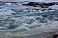 SPUR OF ICE, ICEBERGS ON LAKE JOKULSARLON, AN EXTENSION OF THE VATNAJOKULL GLACIER OR GLACIER OF LAKES, THE LARGEST ICECAP IN ICELAND, POSSIBLY EVEN E...