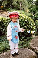China, Hong Kong, little girl in traditional dress.