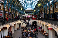 England, London, Covent Garden. Shops and restaurants in the covered market designed in 1632 by Inigo Jones in the centre of Covent Garden