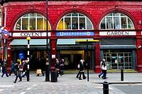England, London, Covent Garden. People passing the entrance to Covent Garden Underground Station.