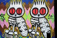 England, London, Near Brick Lane. Graffiti depicting two owls just off Brick Lane in London's east end