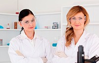 Two scientists posing in a lab