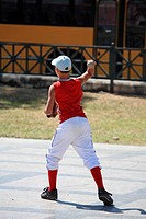 Cuba, Havana, child playing baseball