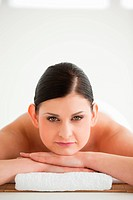Dark_haired woman getting a spa treatment while looking at the camera