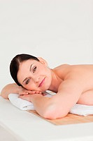 Attractive dark_haired woman relaxing in a spa centre