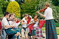 Chamber music entertains visitors at Crathes Castle, near the town of Banchory in Deeside, Grampian Region, Scotland