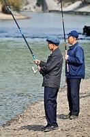 Guilin (China): two men fishing along the Li River