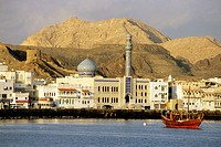 Mutrah, Oman  An Arab dhow, a Shia mosque, and traditional waterfront architecture denote the harbor of Mutrah, commercial port for Oman´s capital, Mu...