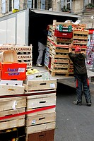 At the end of the market day in Pezenas, unsold produce is loaded on trucks for the next market
