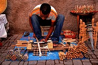 Wood turner, making handles for kebab skewers using primative lathe, Marrakech, Morocco