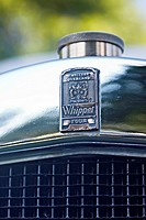 Badge on the grill of a 1928 Willeys Overland Whippet Four