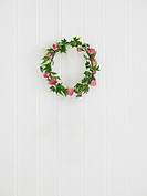 Wreath hanging on white wall