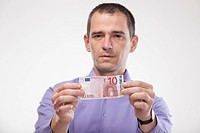 Mature man holding euro note
