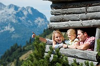 Austria, Salzburg Country, Filzmoos, Family on a hide at alpine