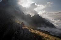 Austria, Salzburg, Filzmoos, Couple hiking on mountains