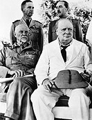 CASABLANCA CONFERENCE.Prime Minister Winston Churchill of Great Britain (right foreground) photographed with (clockwise from left) Field Marshal Jan C...