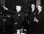 HUGH SAMUEL JOHNSON(1882-1942). American army officer and politician. General Johnson (hand raised) presenting President Franklin D. Roosevelt to a gr...