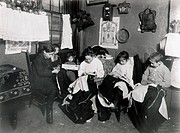 ITALIAN IMMIGRANT FAMILYdoing garment piecework in their New York City tenement home, c1905.