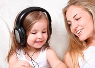 Mother and daughter listen to the music