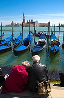 Tourists at Piazza San Marco waterfront with San Giorgio Maggiore church in background Venice Italy Europe