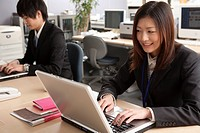 Young businessman and businesswoman working at office