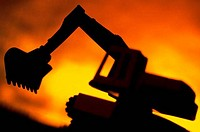Silhouette of an excavator
