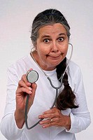Close_up of a female doctor holding a stethoscope