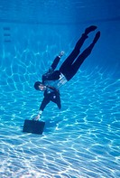 Businessman with a briefcase underwater