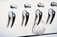 Close_up of a knob and handles on a stove