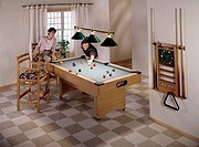 High angle view of a young couple playing pool