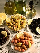 High angle view of assorted olives in plates