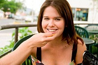Portrait of a young woman eating food