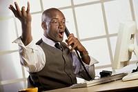 Businessman talking on a landline telephone
