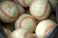 Close_up of baseballs